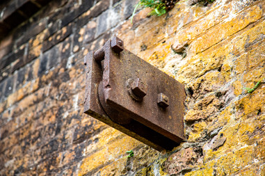 This is at the front door. I imagine it was part of the pulley system for the moat bridge.