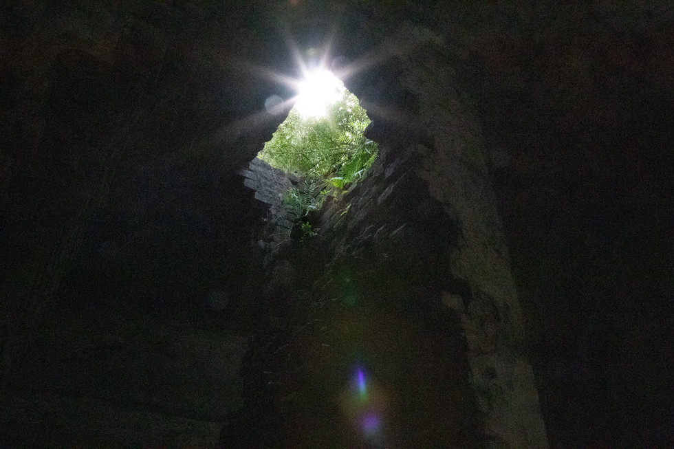 Looking up from inside the citadel through a hole where a chimney once stood.