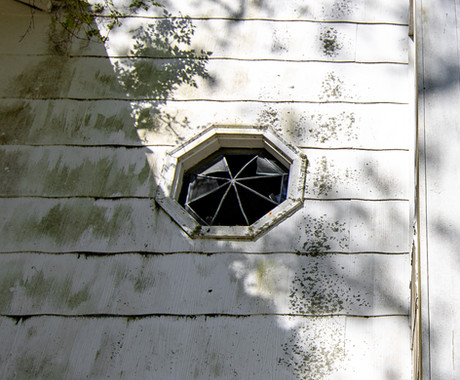 I missed a shot of this window from the inside. It's on the stairwell I got a shot of from the bottom.
