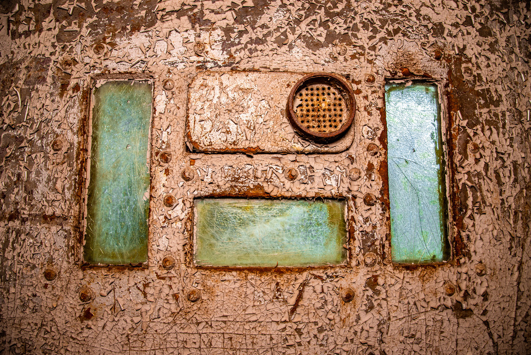 From inside a cell, I imagine the green glass was once transparent.