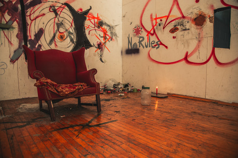 This is an old raquet ball room. When we walked in that candle was already burning. No joke!