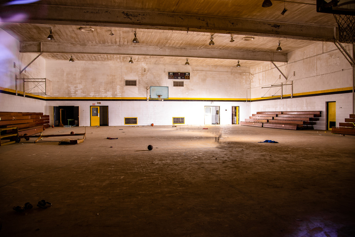 There is zero light in the gym. Even during the day. It may be why it is in better shape than the rest of the buildings. You can see a shimmer of my exploring partner as they walked around light painting the gym walls & floor.