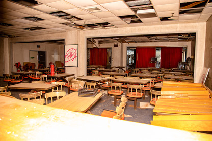 In the cafeteria the tables & chairs resemble the old Burger King's.