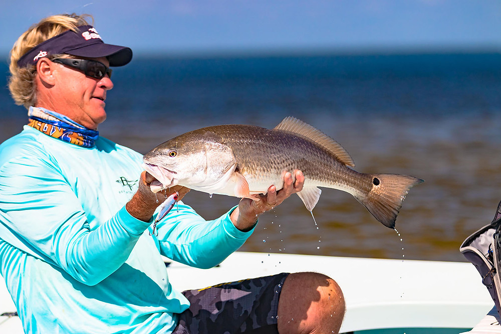 Capt Blair Wiggins with Pine Island Redfish
