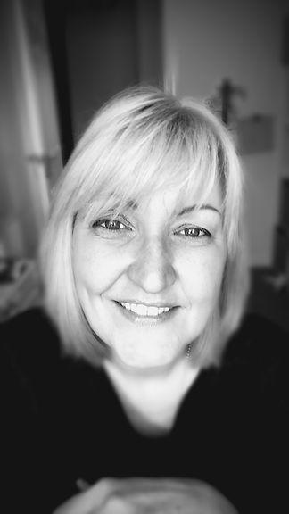 Head shot in black and white of carolann smith smiling