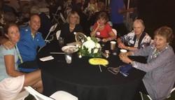 Long time members enjoy dinner