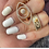 Thumbnail: Savina Interlock Evil Eye Ring.
