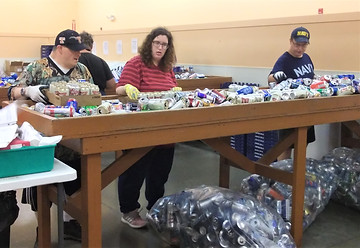 workers sorting cans