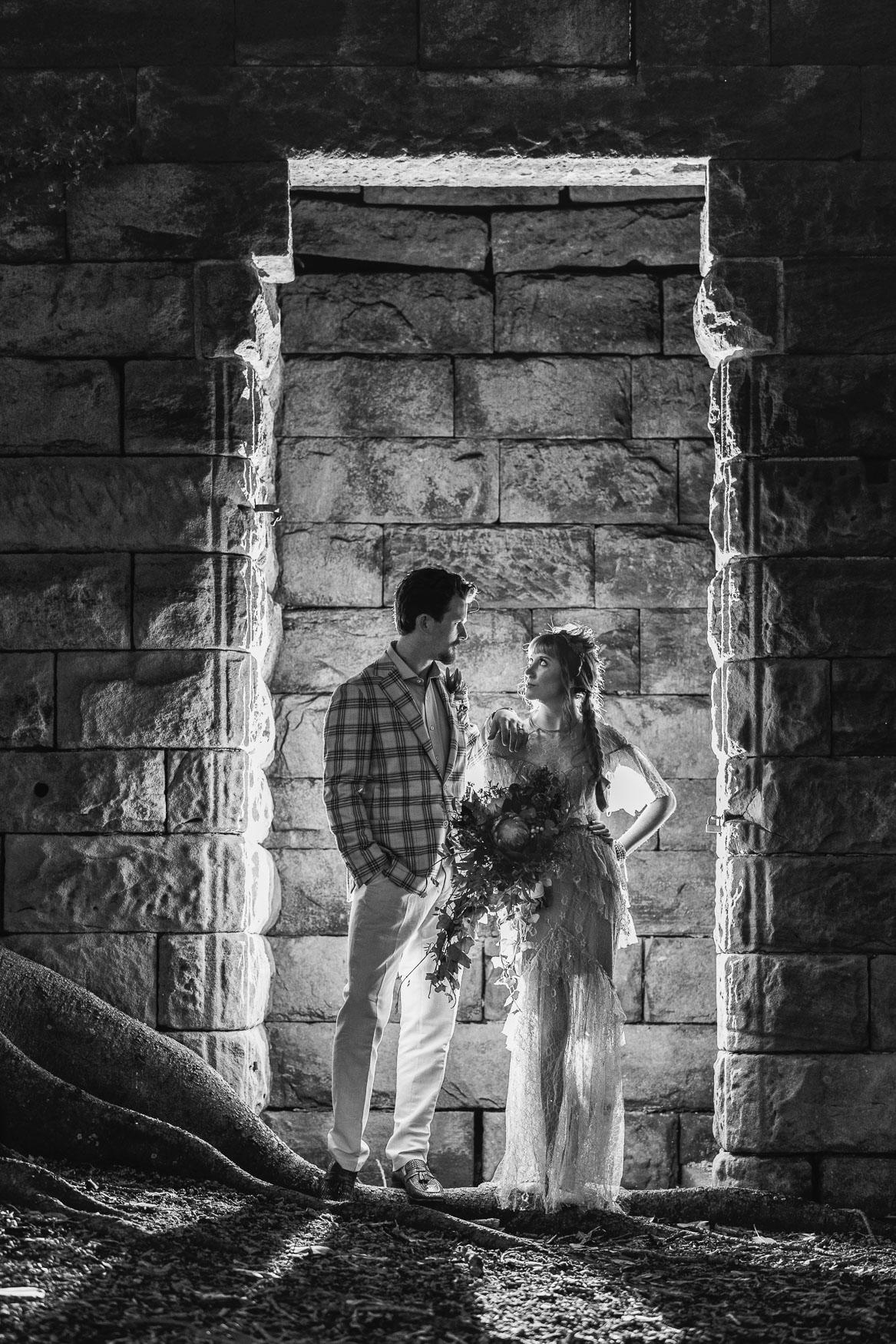 Elopement wedding photo of couple standing in a doorway.
