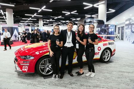 Sydney corporate photography of event staff in front of a car at ICC Sydney