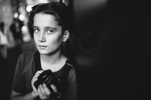 Sydney childrens portrait photography of a boy with a camera in black and white.