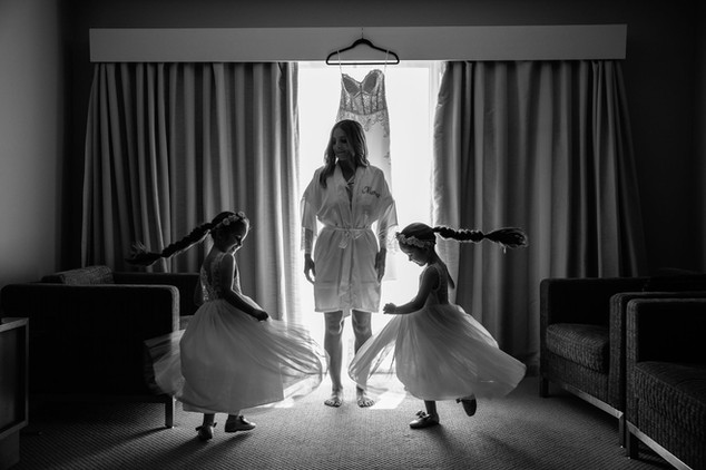Sydney wedding photography of bride & flower girls dancing.