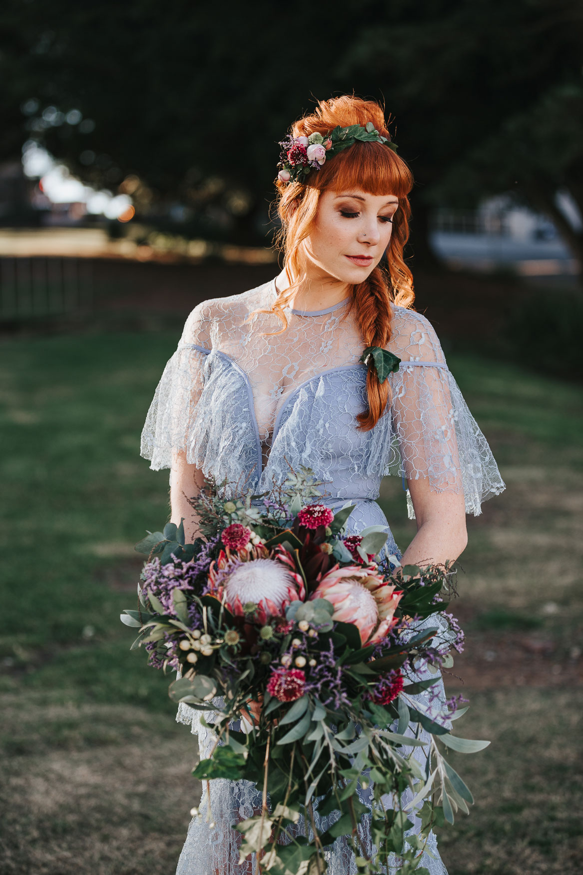 Elopement bride with boho style flowers