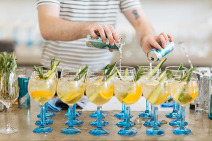 stunning event photography of a bartender making delicious cocktails.