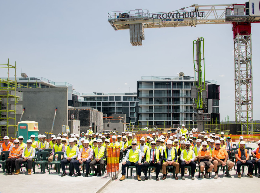 Commercial photography in sydney of topping out ceremony on construction site.