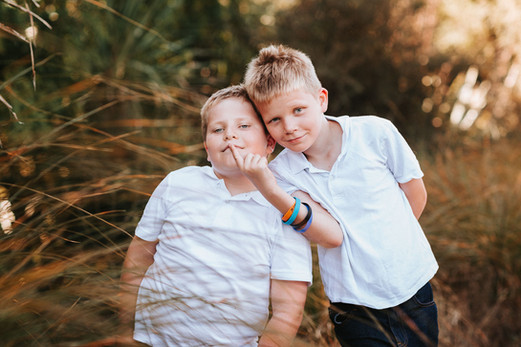 Sydney family photography of twins in a grass field.