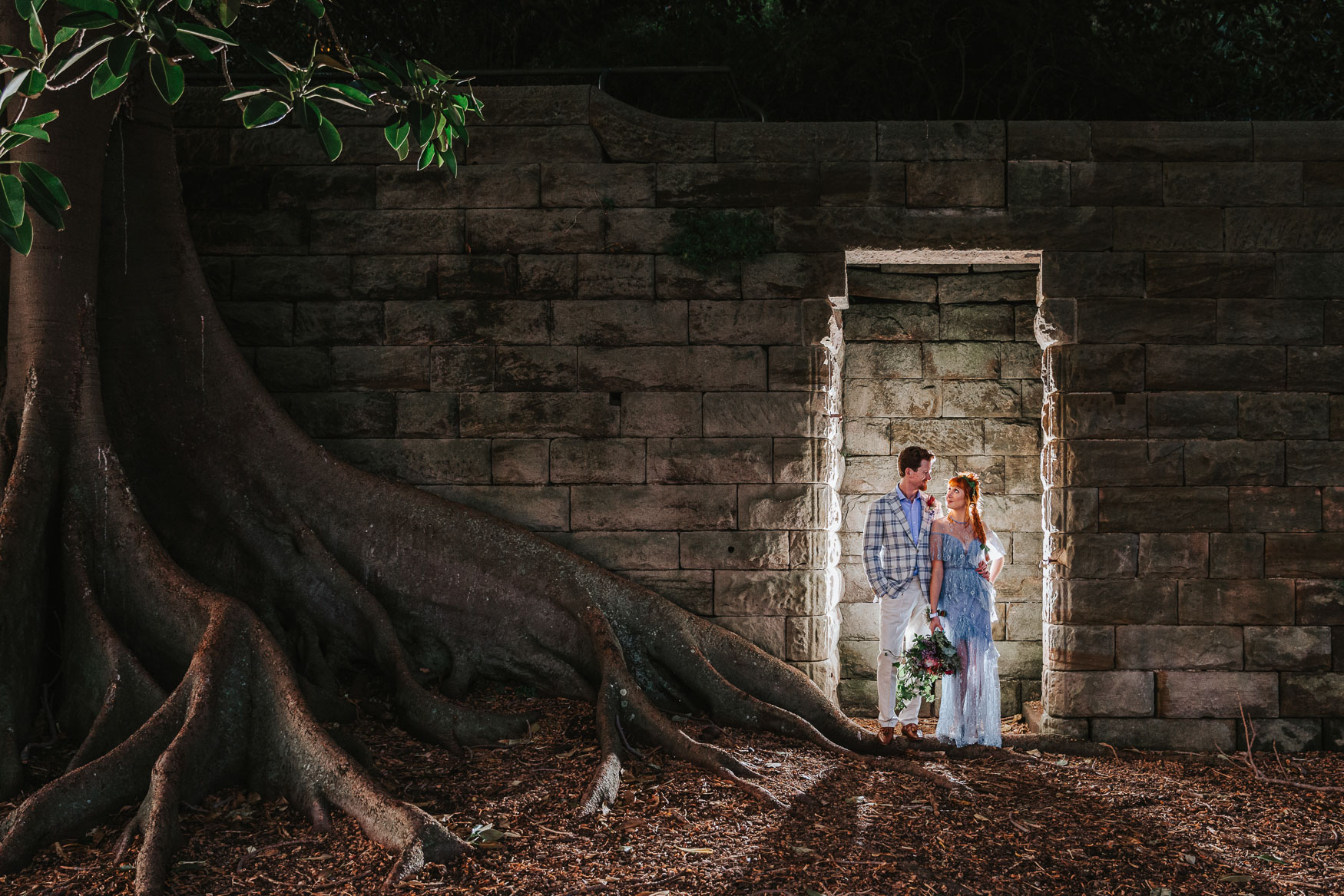 Elopement photography of couple framed by a doorway.