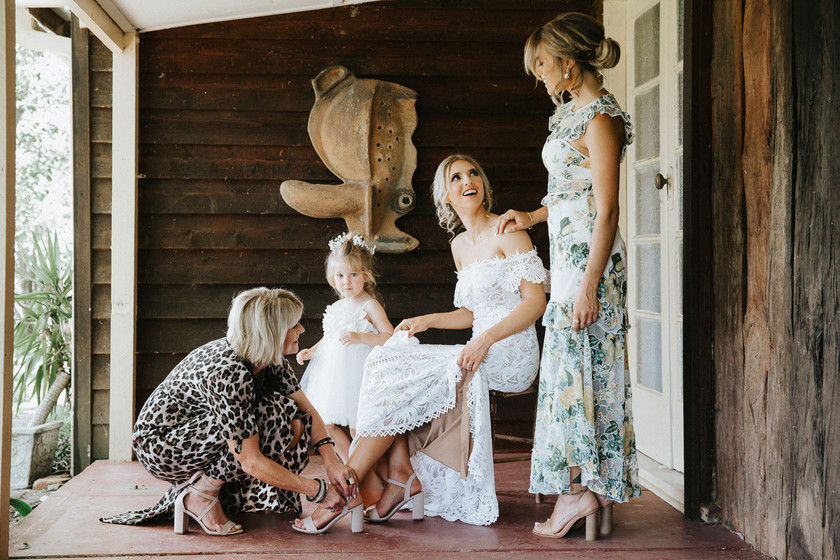 Country wedding photography of the bridal party during bridal preparations.