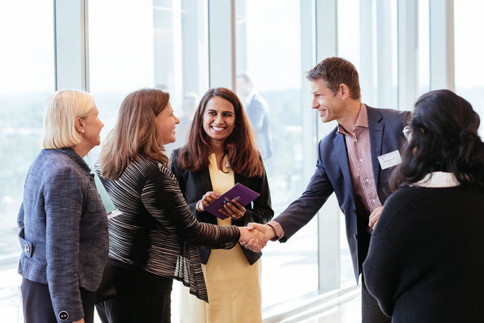 Sydney event photography: business meetings start with a friendly handshake.