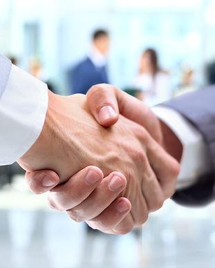 Business handshake and business people.j