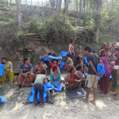 Villagers with waterproof covers after the earthquake 2015