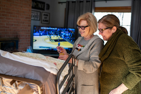 Our dear friends, Beverly Dyer and Kary Hattaway, lost their daughter/sister, Kristi Randolph, in a car accident few years ago. They always brought the spirit of Kristi when visiting, and often mourned while also visiting Mom. Here Beverly is feeding Mom pureed carrot as Kary looks on.