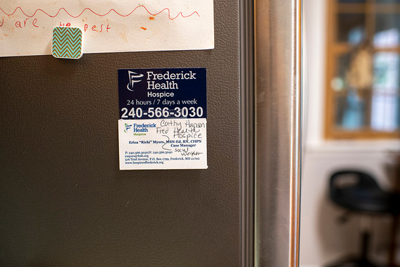 A magnetic business card affixed to the refrigerator for medical needs. They are available 24 hours a day if our main nurse Ricki is not available to answer our calls.
