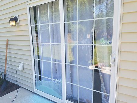 Broken patio door glass