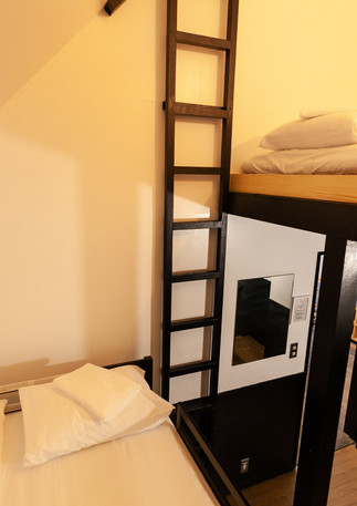 View of loft and upper bunk bed.