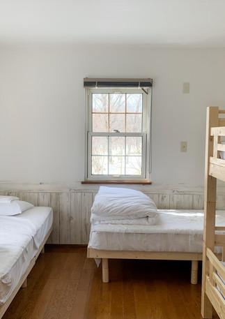 2 x single beds + bunk beds