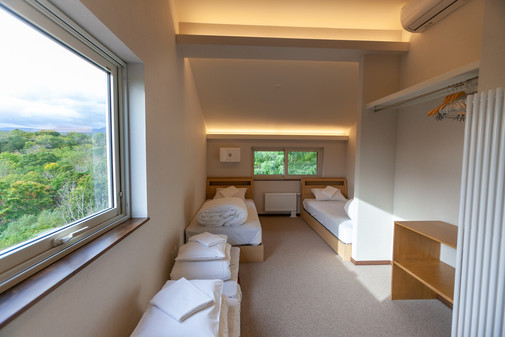 Childrends room with twin beds and futons