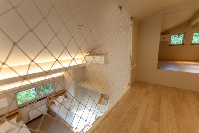 Kids playroom above bedroom