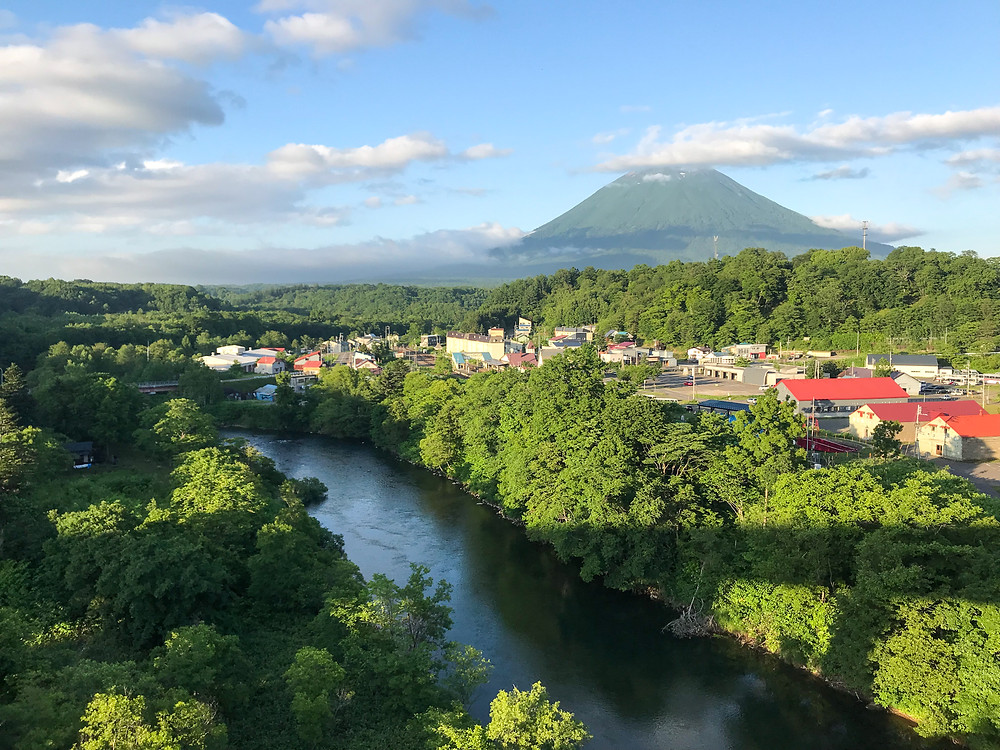 Niseko town in summer with mount Yotei in the backgrounnd.