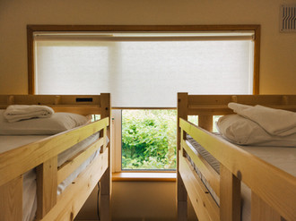 Large window in bunk bedroom