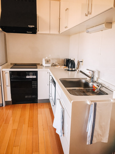 Kitchen with oven, stove, dishwasher and sink