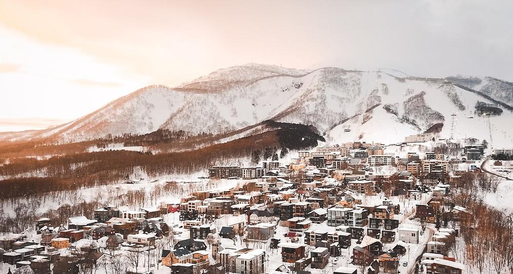 Hirafu Village with Niseko Grand Hirafu ski resort in the background.