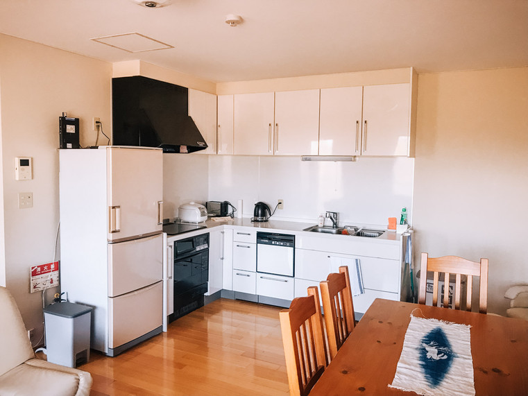 Kitchen is filled with appliances and cooking utensils/platese etc