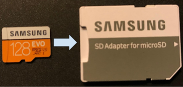 Close-up of MicroSD card being inserted into adaptor
