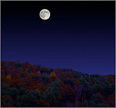 Image of moonrise over New Hampshire fall colors.