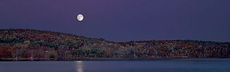 Moonrise at the Lake - Photograph by Ken Schuster.
