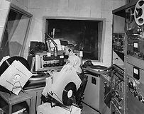 Ken Schuster at the KANU Radio (AFRTS) microphone in 1965. Kagnew Station, Asmara, Eritrea (province of Ethiopia at that time).