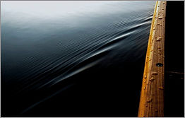 Image of water ripple by canoe on New Hampshire lake.