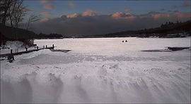 Snowmobiles on Lake Sunapee - Photograph by Ken Schuster.