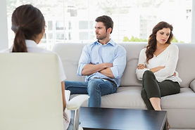 Psychologist helping a couple with relat