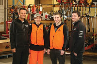 2 young apprentices with 2 employment support workers, all smiling