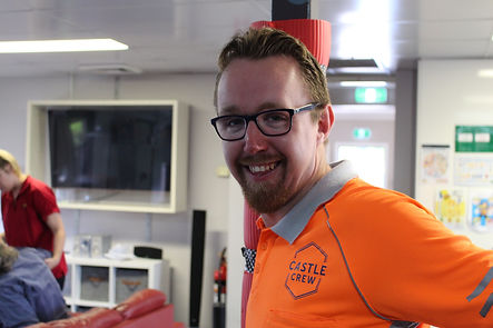 A young male NDIS participant, wearing a high vis work crew shirt