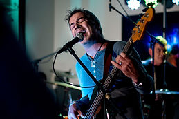 Steve Wilson playing bass with the Treefrogs