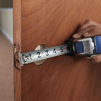 Man measuring door for prep