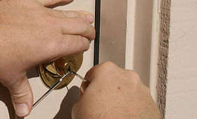 Man picking deadbolt