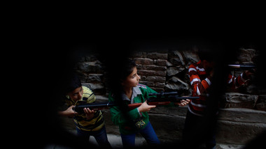 Kashmiri boys playing with toy guns in an alley in Down Town, Srinagar.